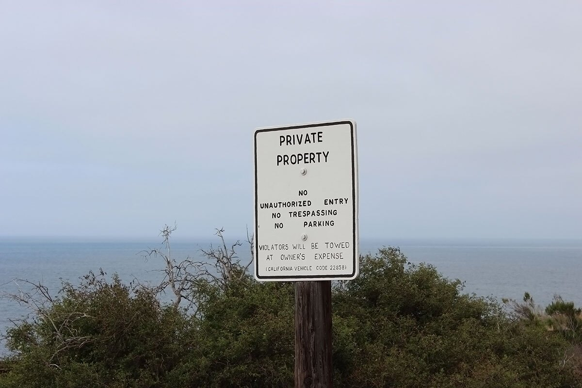 Private property sign overlooking ocean. | Spencer Robins